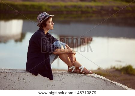 Young Woman Sits And Rests