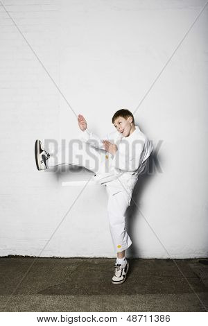 Full length of a young boy practicing judo