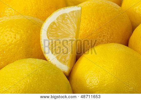 Background Of Yellow Ripe Lemons.