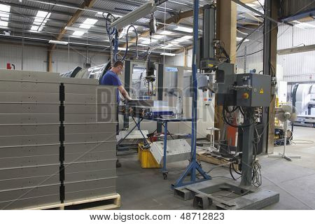 Worker at manufacture workshop operating machine