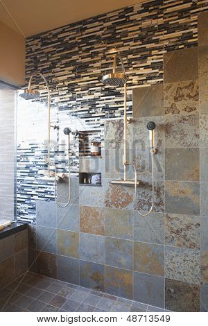 Contrasting tiles in wet room with double shower head