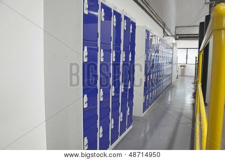 Factory locker room along narrow passageway