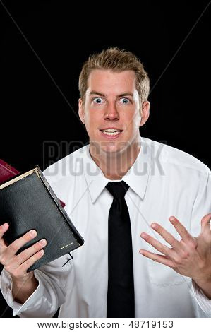 Enthusiastic Young Man Holding Bibles