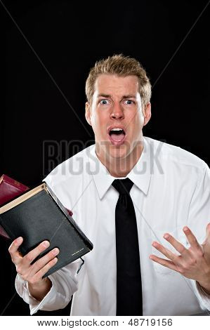 Anguished Young Man Holding Bibles