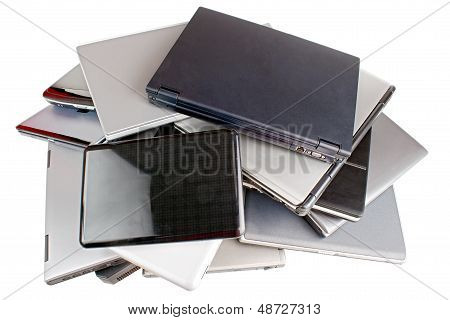 Pile of used laptops