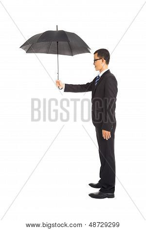 Smiling Businessman Holding Umbrella Standing