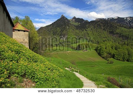 Gruyere Castle,footpath And Alps Mountains, Gruyeres, Switzerlan