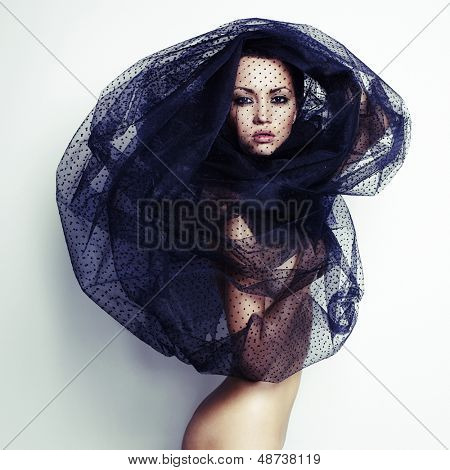 Sensual beautiful woman under the black veil