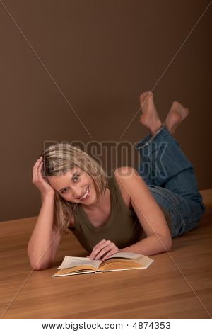 Student Series - Blond Young Woman Reading