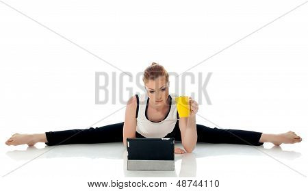 Concept of multi-tasking - Gymnast working on PC