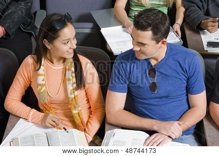 Student couple sitting in lecture hall