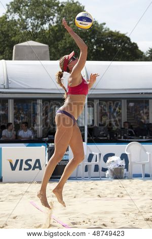 10/08/2011 LONDON, ENGLAND,  Lisa Rutledge (USA) serves during the FIVB International Beach Volleyball tournament, at Horse Guards Parade, Westminster, London.