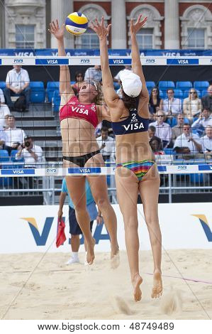 10/08/2011 LONDON, ENGLAND,  Lucy Boulton & Denise Johns (GBR) vs Tealle Hunkus & Heather Lowe (USA) during the FIVB Beach Volleyball tournament, at Horse Guards Parade, Westminster, London.