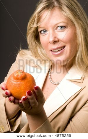 Attractive Blond Woman With Mineola Orage Tangerine  Fruit For Healthy Life