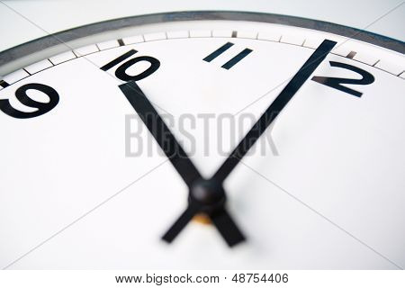 Macro shot of a clock face showing ten o�¢??clock