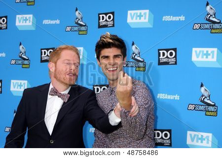 LOS ANGELES - JUL 31:  Jesse Tyler Ferguson, Justin Mikita arrives at the 2013 Do Something Awards at the Avalon on July 31, 2013 in Los Angeles, CA