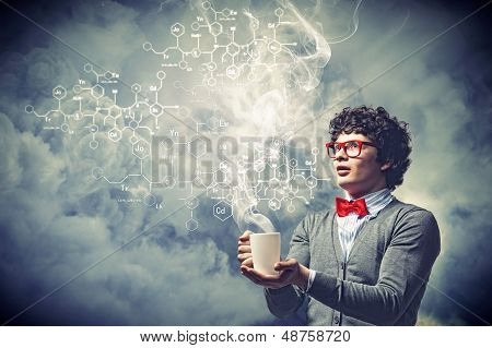 Young man with smoke coming out of cup
