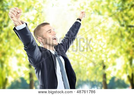 Successful business man with arms open