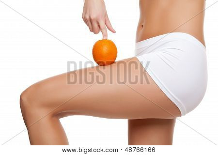Woman With An Orange Showing A Perfect Skin