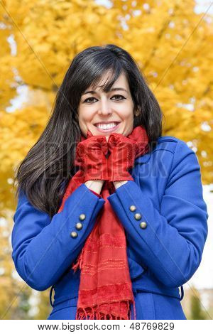 Cheerful Woman Is Cold In Autumn