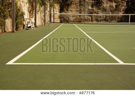 Looking Down A Backyard Tennis Court Tramline