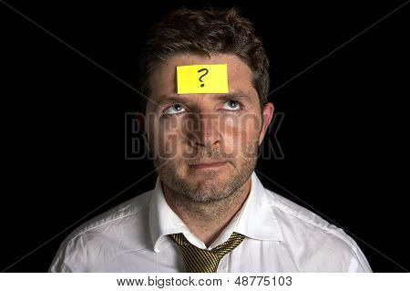 Man With Yellow Post it Note On His Forehead