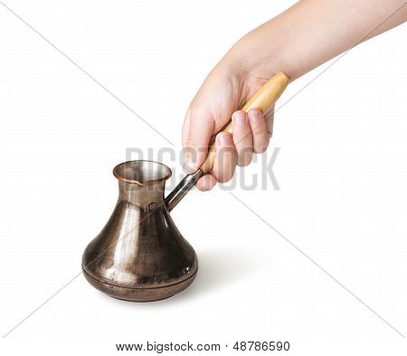 Hand with coffee pot