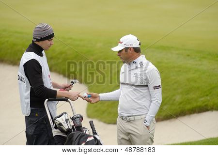 MOSCOW, RUSSIA - JULY 27: Terry Pilkadaris of Australia with his caddie during 3rd round of the M2M Russian Open at Tseleevo Golf & Polo Club in Moscow, Russia on July 27, 2013