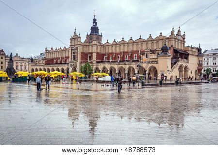 CRACOW, POLAND - JUNE 28: Rainy day on the main market square of the Old Town in Krakow on 28 June 2013. Main square in Krakow is the largest medieval town square in Europe.