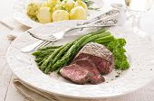 stock photo of ribeye steak  - steak with asparagus - JPG
