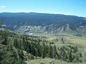 picture of cariboo  - The lake is seen from the forest trees and the hills - JPG
