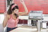 pic of jukebox  - Beautiful young woman listening to music in a diner - JPG