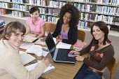 picture of shelving unit  - Four University students studying in library - JPG