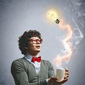 stock photo of mad scientist  - Young man with smoke coming out of a cup experimenting - JPG