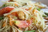 stock photo of papaya  - Green papaya salad Thai cuisine spicy delicious  - JPG
