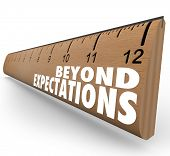 stock photo of long distance  - The words Beyond Expectations on a ruler to illustrate great results - JPG