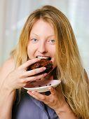 Female Eating A Brownie