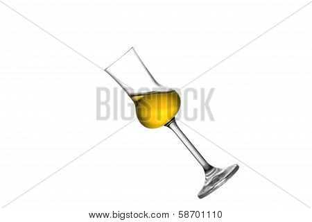 A tilted grappa glass