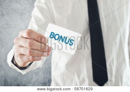 Businessman Holding Bonus Card.