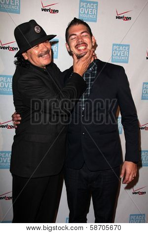 Carlos Santana and Salvador Santana at the Peace Over Violence 42nd Annual Humanitarian Awards, Beverly Hills Hotel, Beverly Hills, CA 10-25-13