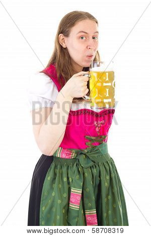 Woman In Dirndl Drinking Delicious Beer At Oktoberfest