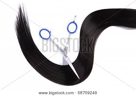 Long black hair and scissors isolated on white