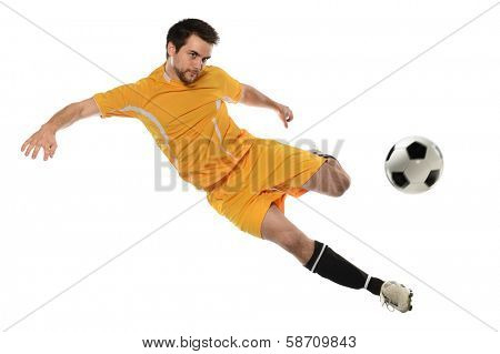 Young soccer player kicking ball isolated over white background