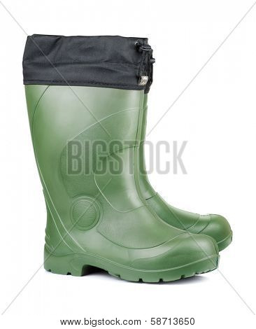 Pair of green rubber boots isolated on white