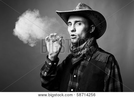 Portrait Of Man. The Man Smokes A Cigar
