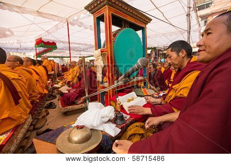 KHATMANDU, NEPAL - DEC 17: Unidentified tibetan Buddhist monks near stupa Boudhanath during festive Puja of H.H. Drubwang Padma Norbu Rinpoche's reincarnation's, Dec 17, 2013 in Khatmandu, Nepal.