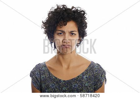 Portrait Of Sulky Hispanic Girl Puffing