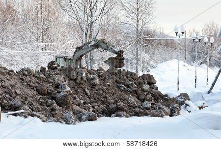 Excavator Digging Frozen Ground