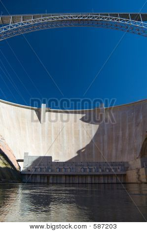 Water Level View Of Glen Canyon Dam And Bridge, Page, Arizona