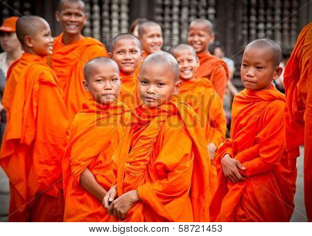 ANGKOR WAT, CAMBODIA - NOV  20,2013: Buddhist monks in Angkor Wat complex on Nov 20, 2013.Cambodia. Angkor Wat was first a Hindu, then subsequently, a Buddhist temple complex in Cambodia.